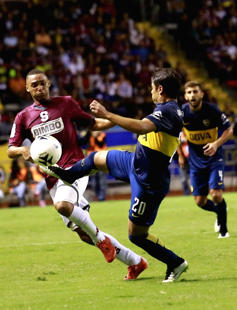 Sebastian Palacios (R) of Argentina's Boca Juniors vies with a player of Costa Rica's Deportivo Saprissa during a friendly match in San Jose, Costa Rica, July 4, ...