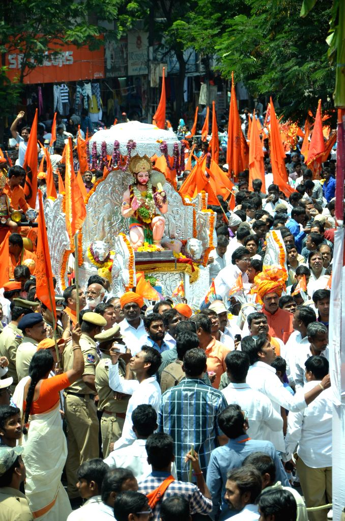 People participate in a procession organised on Hanuman Jayanti `Shobha Yatra` at Secunderabad, on April 4, 2015.