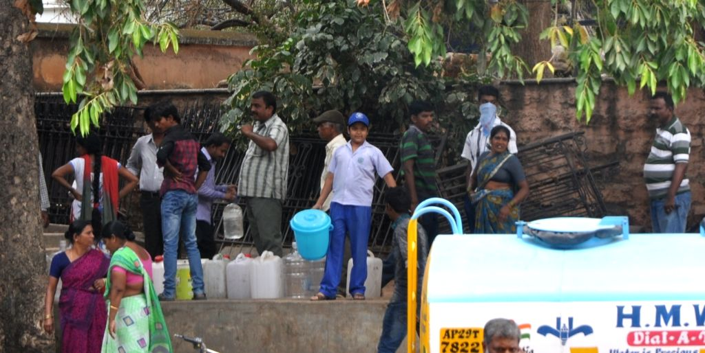 People queue-up to fill their containers in the wake of water scarcity in Secunderabad on April 6, 2015.