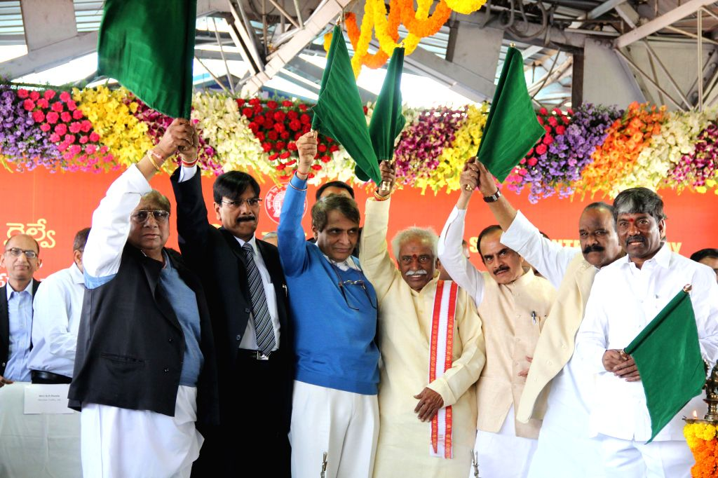 Union Railway Minister Suresh Prabhakar Prabhu flags-off a train connecting Secunderabad to Visakhapatnam in Secunderabad, on Jan 19, 2015. - Suresh Prabhakar Prabhu