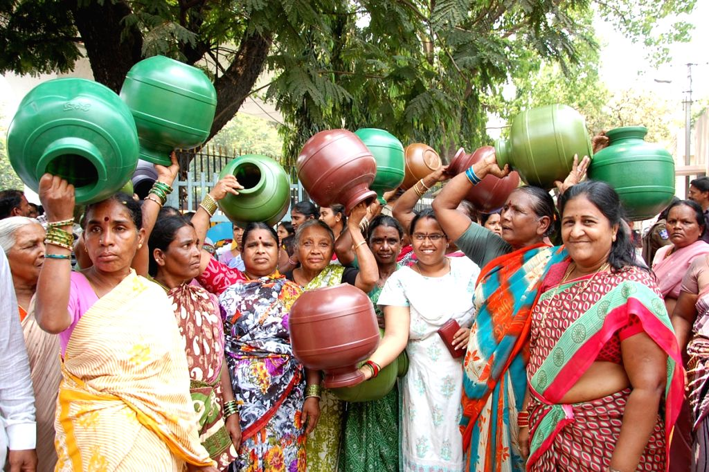 Women wait for a water tanker as water scarcity hits Secunderabad on April 6, 2015.