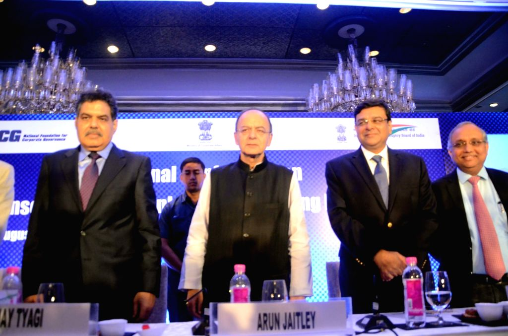 Securities and Exchange Board of India (Sebi) chairman Ajay Tyagi, Finance Minister Arun Jaitley, Reserve Bank of India Governor Urjit R Patel and Confederation of Indian Industry DG ... - Arun Jaitley, Urjit R Patel and Chandrajit Banerjee