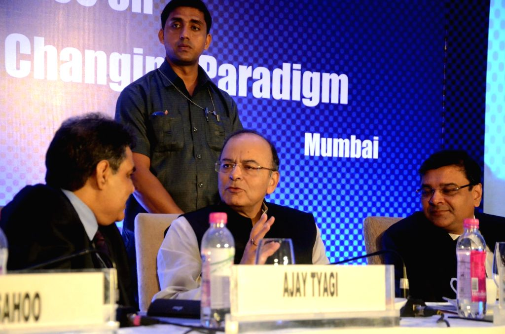 """Securities and Exchange Board of India (Sebi) chairman Ajay Tyagi, Finance Minister Arun Jaitley and Reserve Bank of India Governor Urjit R Patel during """"National Conference on ... - Arun Jaitley and Urjit R Patel"""