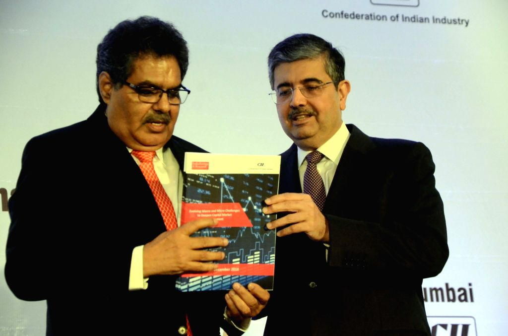 Securities and Exchange Board of India (SEBI) Chairman Ajay Tyagi and Kotak Mahindra Bank MD and CEO Uday Kotak at Financial Markets Summit in Mumbai, on Dec 7, 2018.