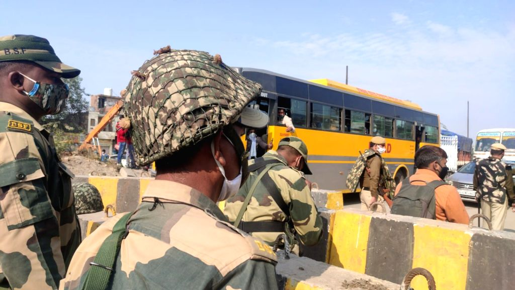 Security beefed up at Delhi borders , traffic diverted as Farmers march towards Delhi.