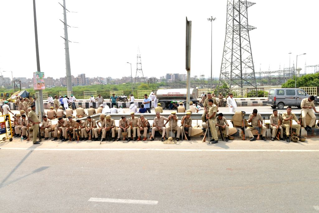 Security beefed up at the Delhi-UP border near Ghazipur where farmers gave gathered to protest demanding payment of sugarcane crop dues, full loan waiver and making electricity used in ...