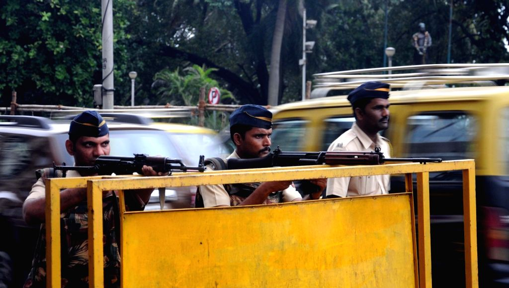 Security beefed up in Mumbai after a high alert was sounded in Maharashtra following reports of suspicious gun toting masked persons being sighted in Uran coastal town; in Mumbai on Sept 22, ...