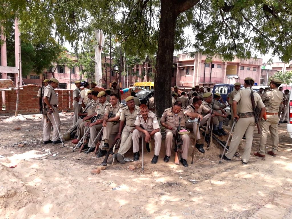 Security beefed up in Ubhbha village of Ghoraval tehsil in Sonbhadra district of Uttar Pradesh on July 18, 2019. Police have arrested 24 people in connection with the mass murder took ...
