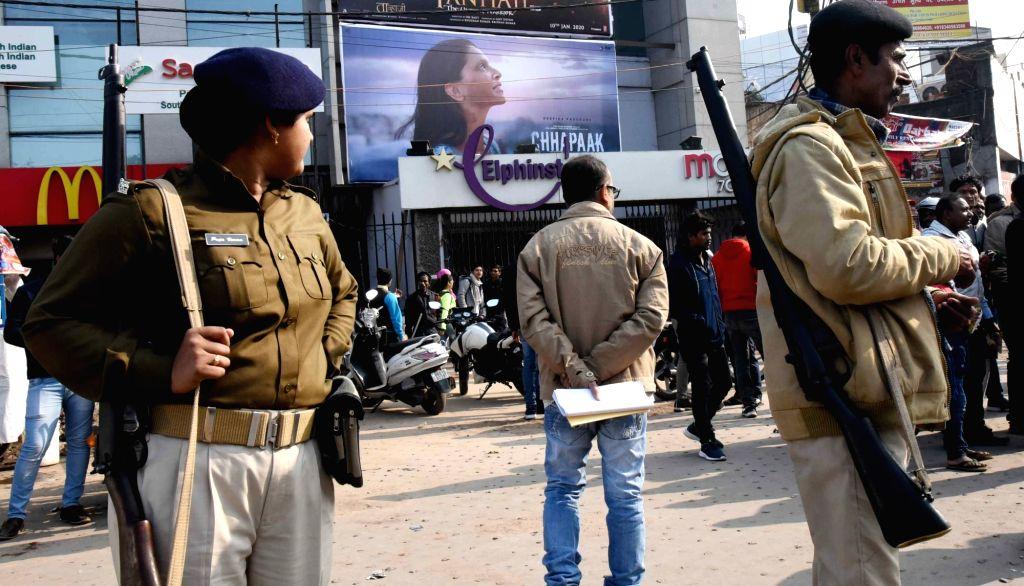 "Security beefed up outside a movie theater during the screening of Deepika Padukone starrer ""Chhapaak"" in Patna on Jan 11, 2020. - Deepika Padukone"