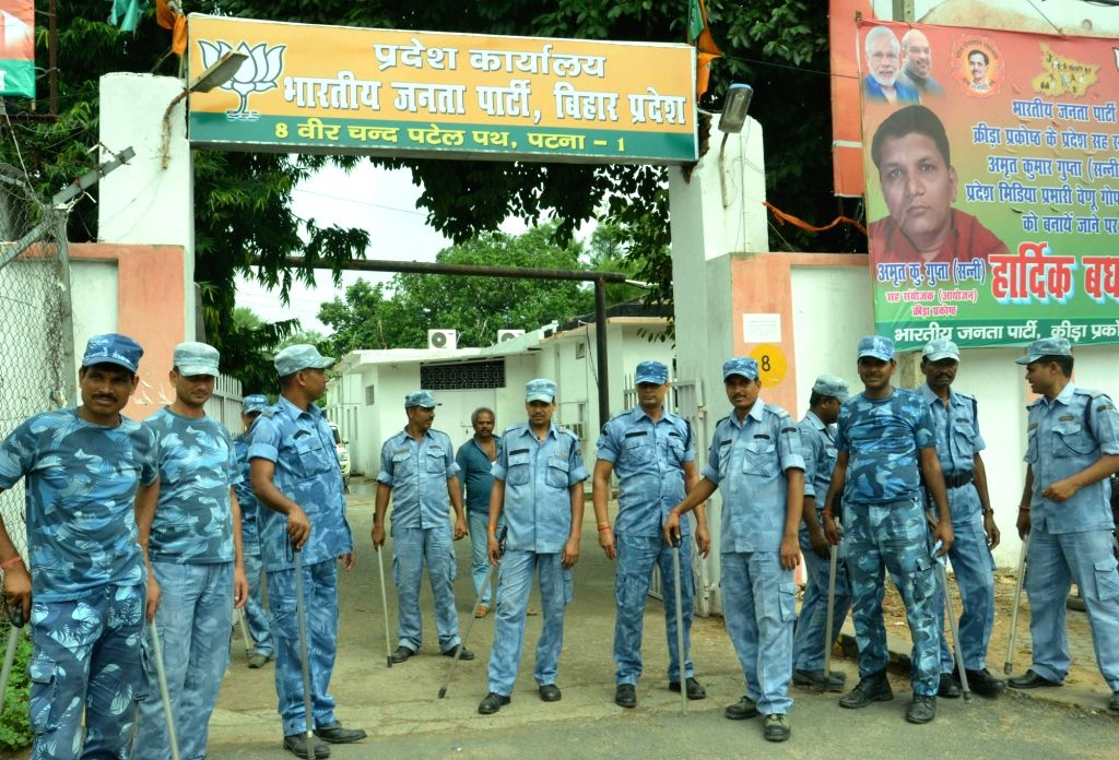 Security beefed up outside BJP office as CBI raids at the residences of RJD chief Lalu Prasad and his family members in connection with a new case of alleged irregularities in awarding the ...