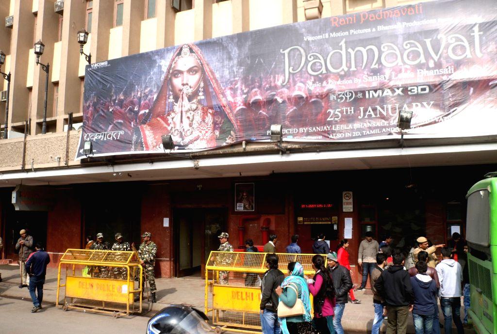 "Security beefed up outside cinema halls as Sanjay Leela Bhansali's ""Padmaavat"" hit the screens; in New Delhi on Jan 25, 2018. The film based on Rajput Queen Padmavati was ..."