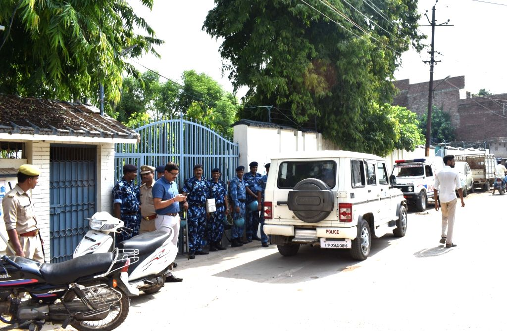 Security beefed up outside one of the properties of mafia don Ateeq Ahmad, who is presently lodged in Ahmedabad Jail, where CBI raids are underway, in Prayagraj on July 17, 2019. The CBI ...