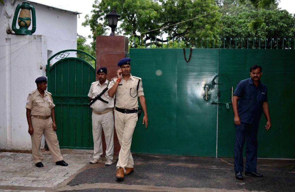 Security beefed up outside Rashtriya Janata Dal (RJD) Supremo Lalu Prasad Yadav's residence as CBI carried out raids at 12 places in Patna, Delhi, Ranchi, Puri and Gurugram in connection with ... - Lalu Prasad Yadav