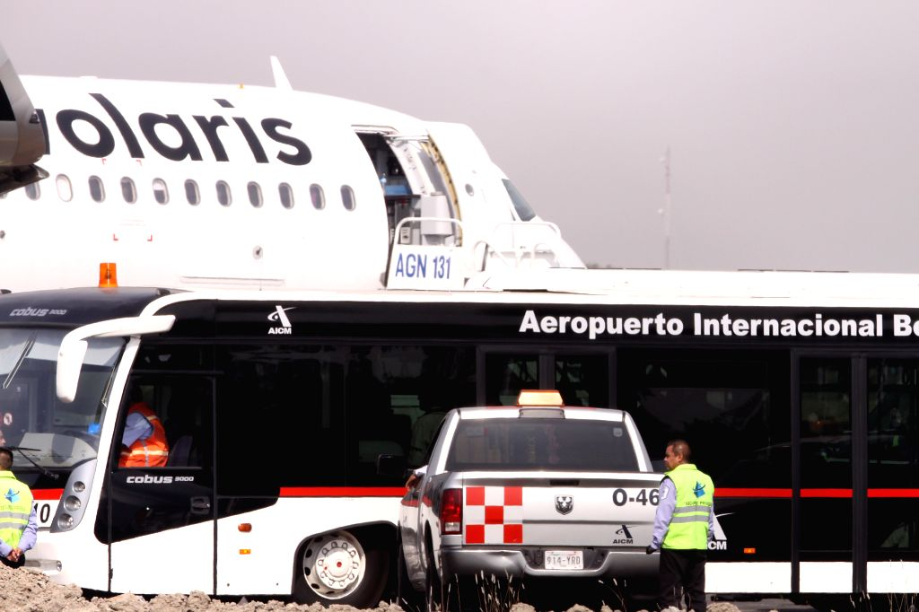 Security elements guard the flight 714 of Volaris airline, in the security zone of the Terminal 1 of the Mexico City's International Airport, in Mexico City, ...