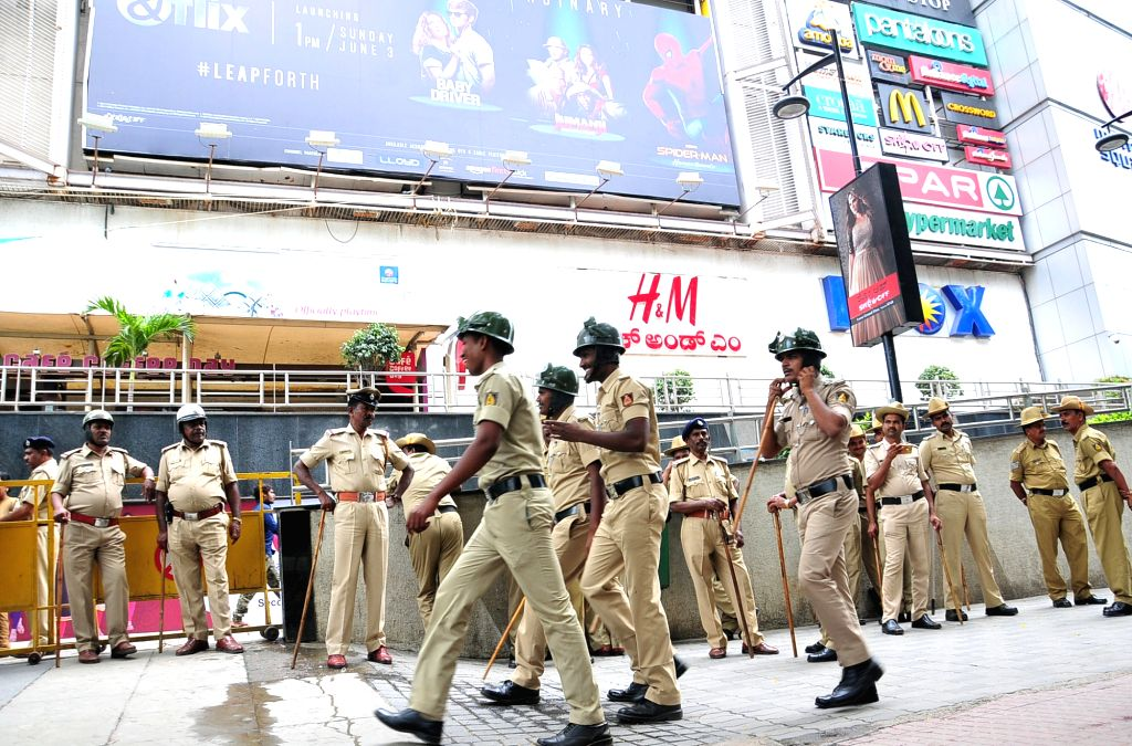 """Security forces deployed outside a mall ahead of the screening of Rajinikanth starrer Tamil film """"Kaala""""amid vociferous protests by pro-Kannada activists against his remarks on ..."""