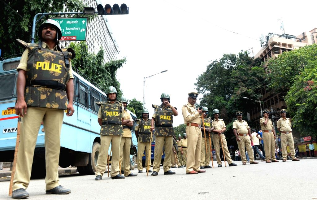 Security forces keep strict vigil following the Pro-Kannada organisations and Farmers Associations called for a Karnataka bandh condemning the Mahadayi Water dispute tribunal order in ...