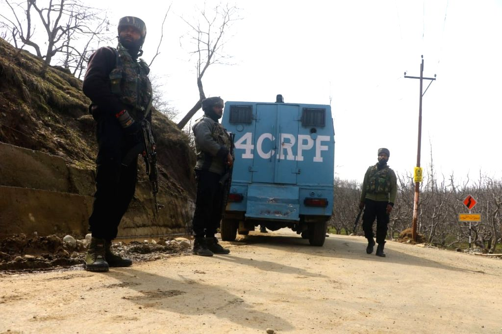 Security forces stand guard near encounter site at Rawalpora Shopian district of South kashmir 15th March 2021. (Photo: Nissar Malik/IANS) - Malik