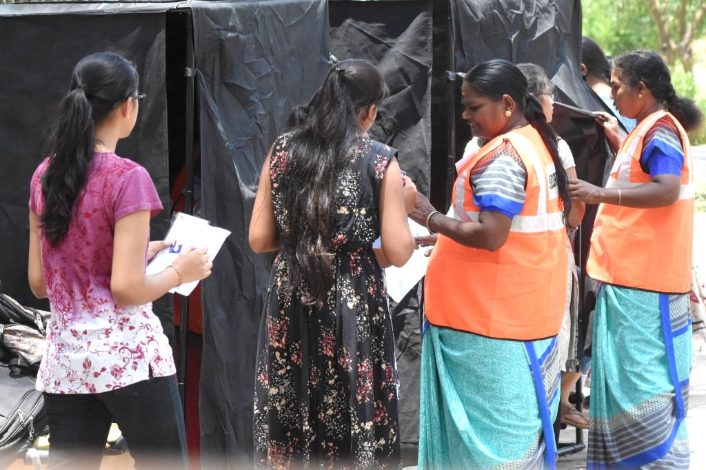 Security guards check an applicants who has arrive for the National Eligibility cum Entrance Test NEET (UG) 2019 in Bengaluru, on May 5, 2019.
