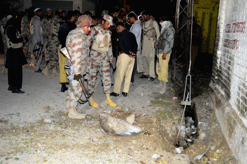 Security officials check an explosion site in Quetta, Pakistan, on Oct. 29, 2015. At least five people were killed and two others injured as a car struck an ...