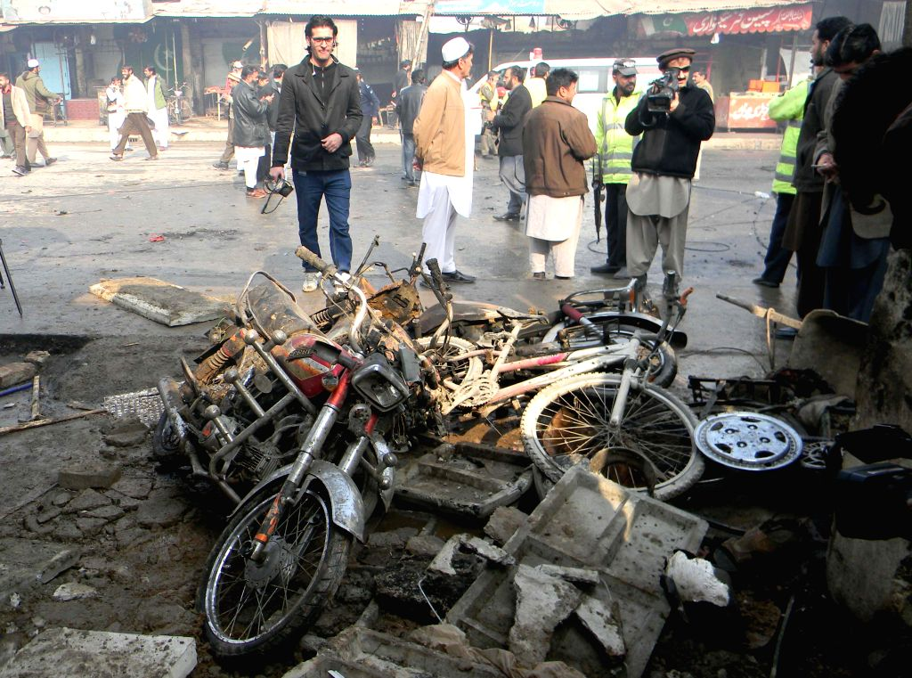 Security officials examine a blast site in northwest Pakistan's Peshawar, Jan. 19, 2016. At least 10 people were killed and 20 others injured on Tuesday morning in ...