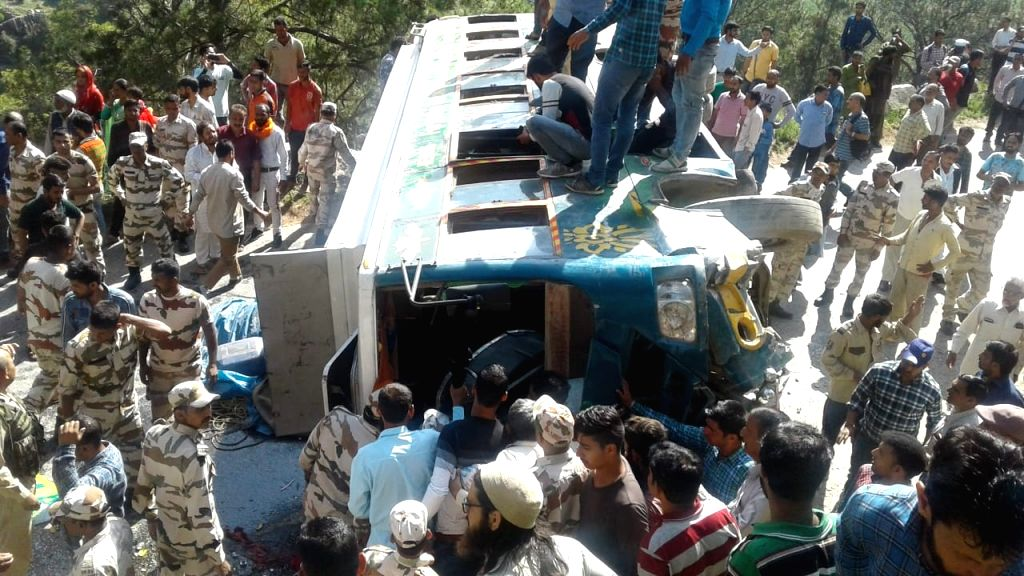 Security personnel and locals engage in rescue operations after a bus carrying over 35 passengers overturned at Gatsu near Doda in Jammu and Kashmir on June 14, 2019. Twenty five passengers ...