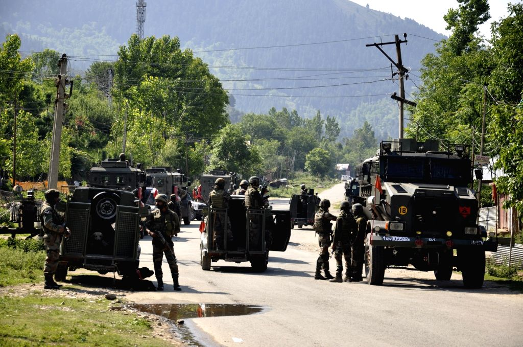 Security personnel at the site where two militants were killed and three soldiers, including an Army officer, injured in a gunfight in Jammu and Kashmir's Anantnag district on June 17, 2019.