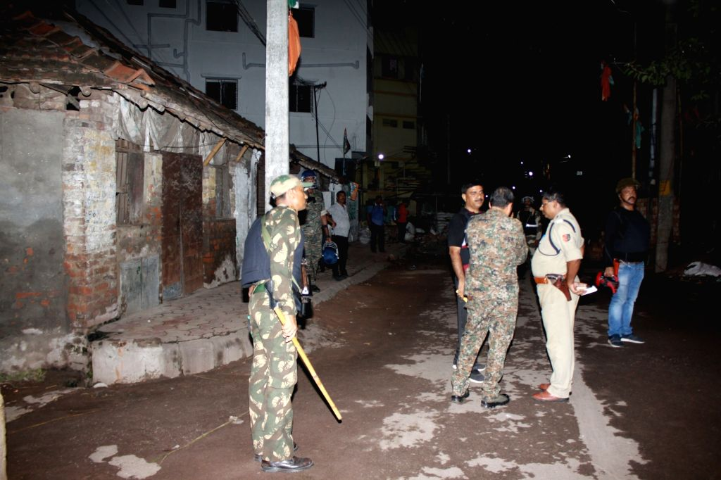 Security personnel at the site where unidentified miscreants allegedly hurled crude bombs and fired several rounds of bullets near the residence of BJP MP Arjun Singh at Bhatpara in West ... - Arjun Singh