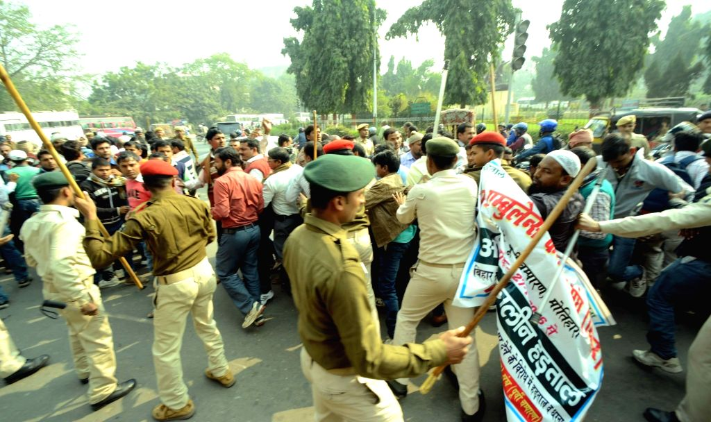 Security personnel baton charge 102 ambulance empolyes during a protest in Patna on Nov 25, 2016.