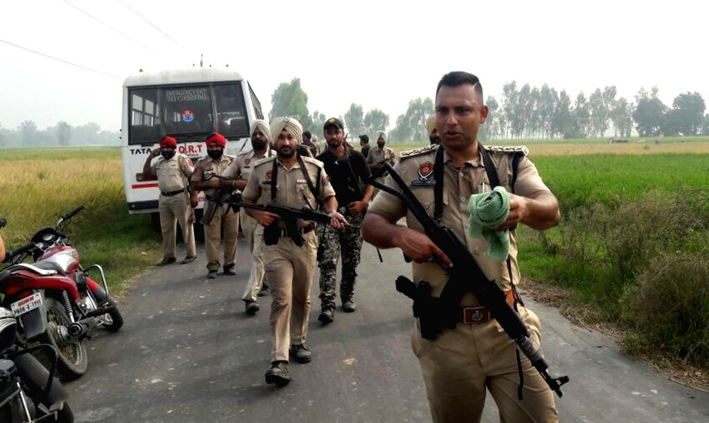 Security personnel carry out combing operations in in Dera Baba Nanak sector in Batala of Punjab after three suspected persons were reported to be seen in the area on Oct 5, 2016.