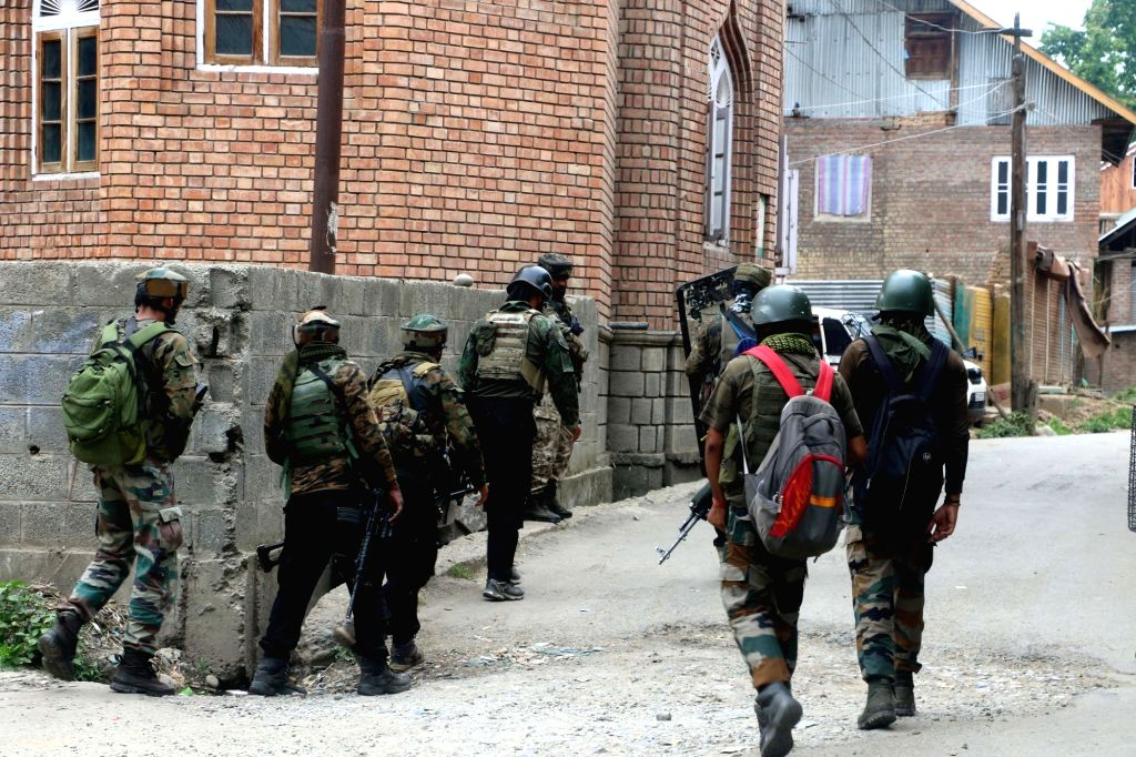 Security personnel carry out cordon and search operations after one terrorist was killed in an encounter at South Kashmir's Kulgam district on July 4, 2020. The encounter started after ...