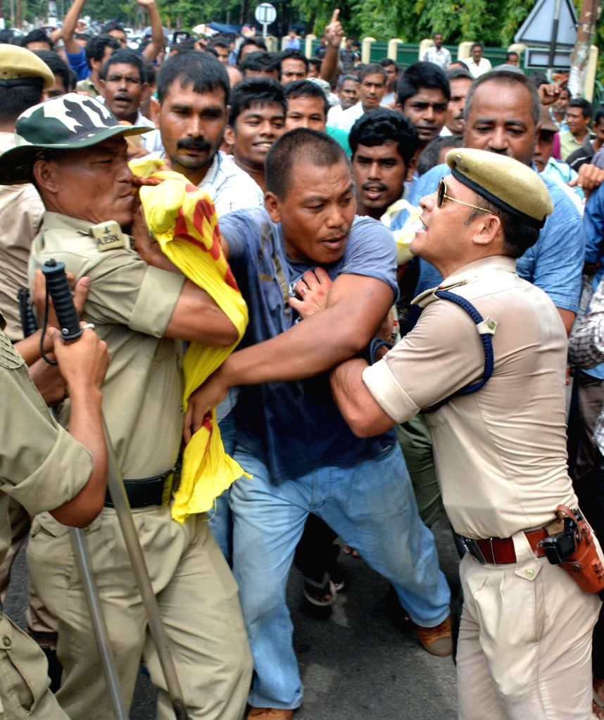 Security personnel charge batons on Krishak Mukti Sangram Samiti  (KMMS) activists as they staged a protest against Assam Govternment's revenue department for allegedly transferring  agricultural ...