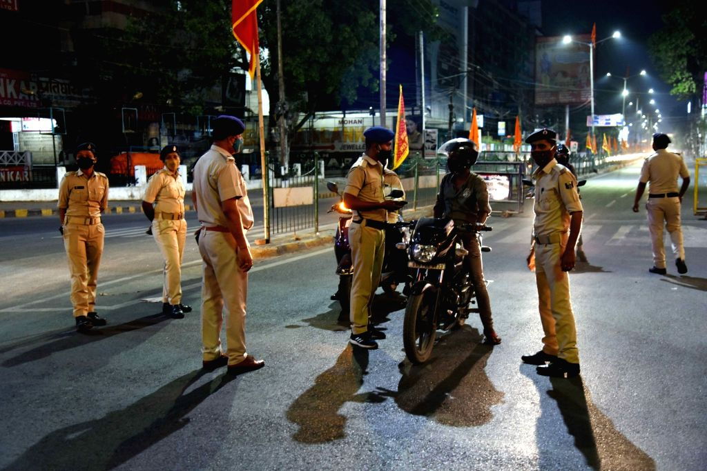 Security personnel check vehicles during the night curfew imposed to curb the spread of Covid-19 cases, in Patna, April 21, 2021.