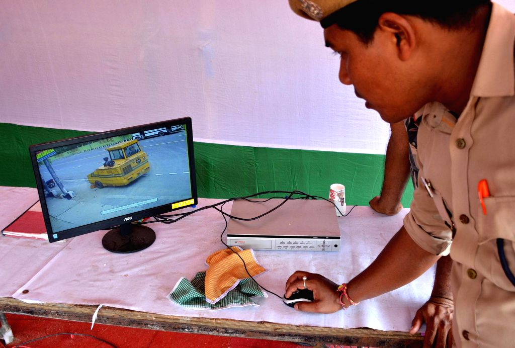 Security personnel checks inside and outside the veterenary field in a desktop connected through the CCTV cameras where the Independence day will be celebrated in Guwahati on Aug 9, 2014.