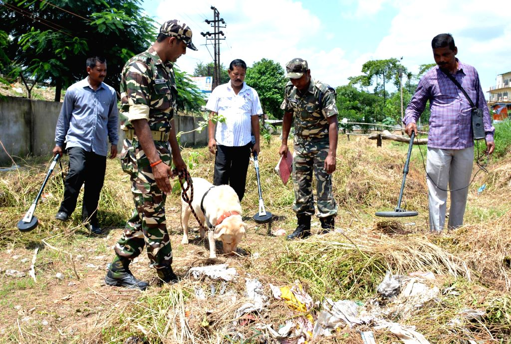 Security personnel checks with sniffer dogs and metal detectors at veterenary field where the Independence day will be celebrated in Guwahati on Aug 9, 2014.