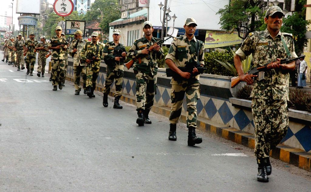 Security personnel conduct flag march a day ahead of 9th phase of 2014 Lok Sabha Elections in Kolkata on May 11, 2014.