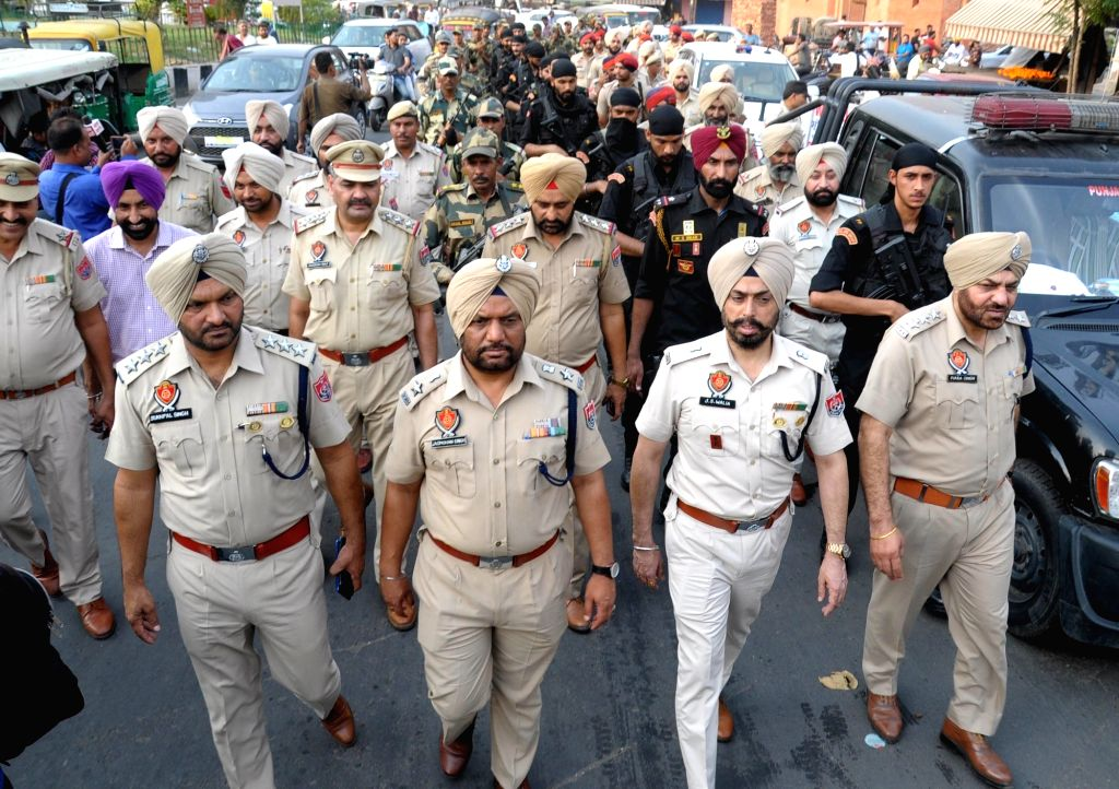 Security personnel conduct flag march ahead of the 35th anniversary of Operation Blue Star in Amritsar, on June 3, 2019.