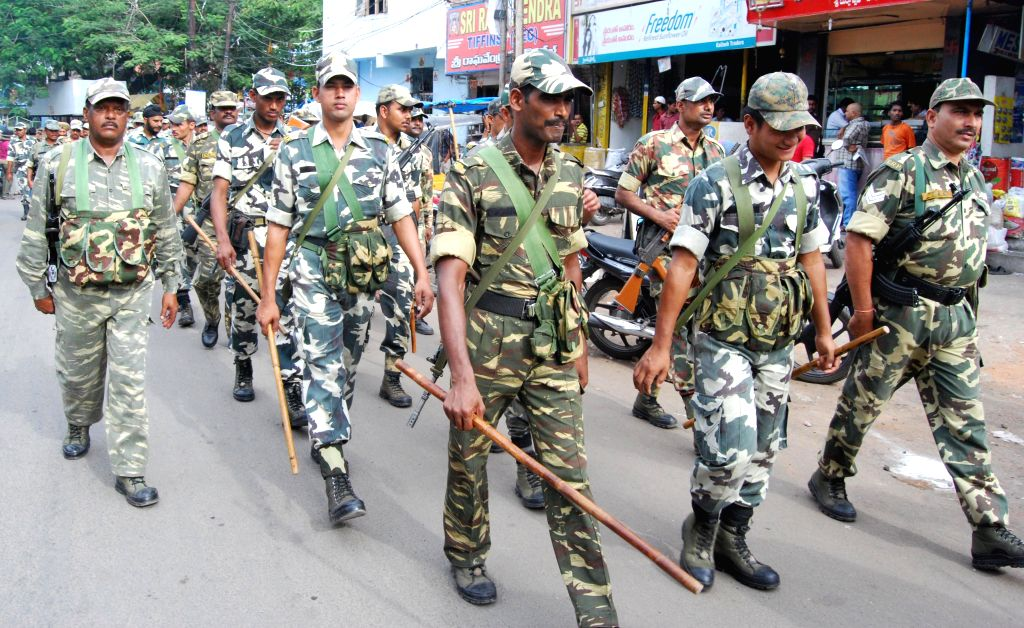 Security personnel conduct flag march on the streets of Hyderabad as the city is observing Ramadan and Bunalu, on July 6, 2014.