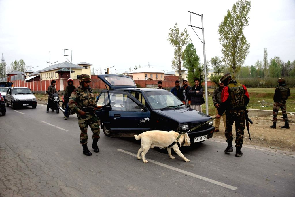 Security personnel conduct security checks amid restrictions imposed by authorities to prevent a protest march to Shopian town announced by separatists  in solidarity with civilians killed ...