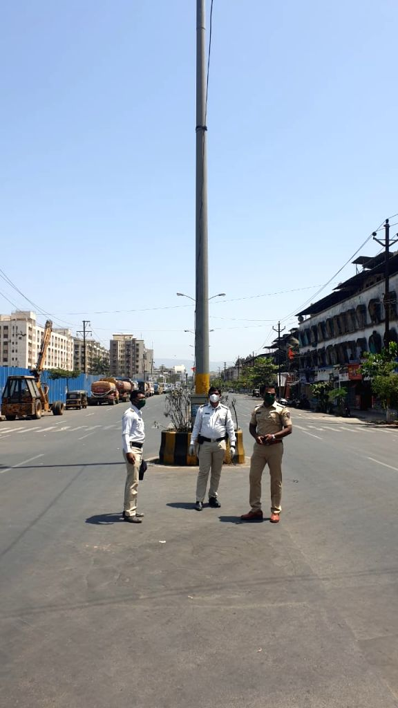 Security personnel deployed in Maharashtra's Palghar to keep vigil during 'Janata Curfew' imposed in the wake of increasing COVID-19 cases, on March 22, 2020.