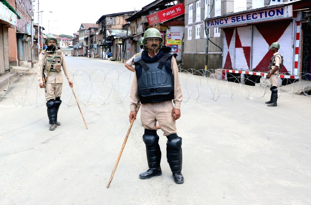 Security personnel deployed on a Srinagar road as authorities imposed restrictions in some areas of the city on June 23, 2017.