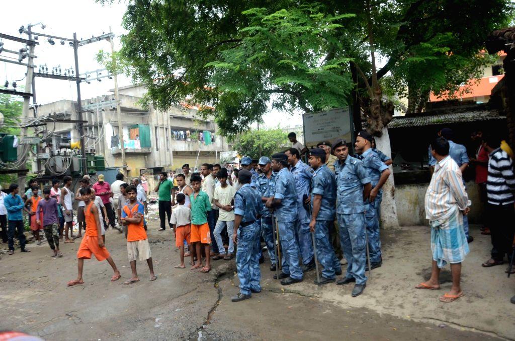Security personnel deployed outside the house of killed RJD leader Kedar Rai in Patna on Aug 10, 2017. - Kedar Rai