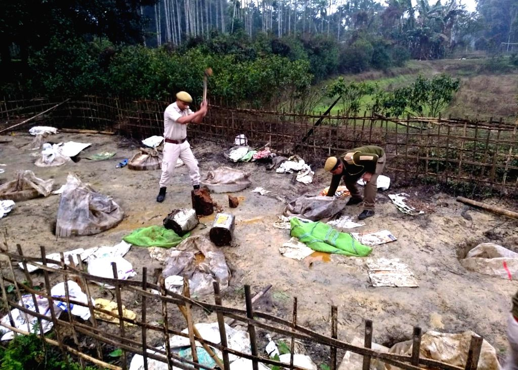 Security personnel destroy illegal country liquor known as 'Sulai mod' in Assamese; in Assam's Golaghat, on Feb 24, 2019. According to source, excise department in association with the ...