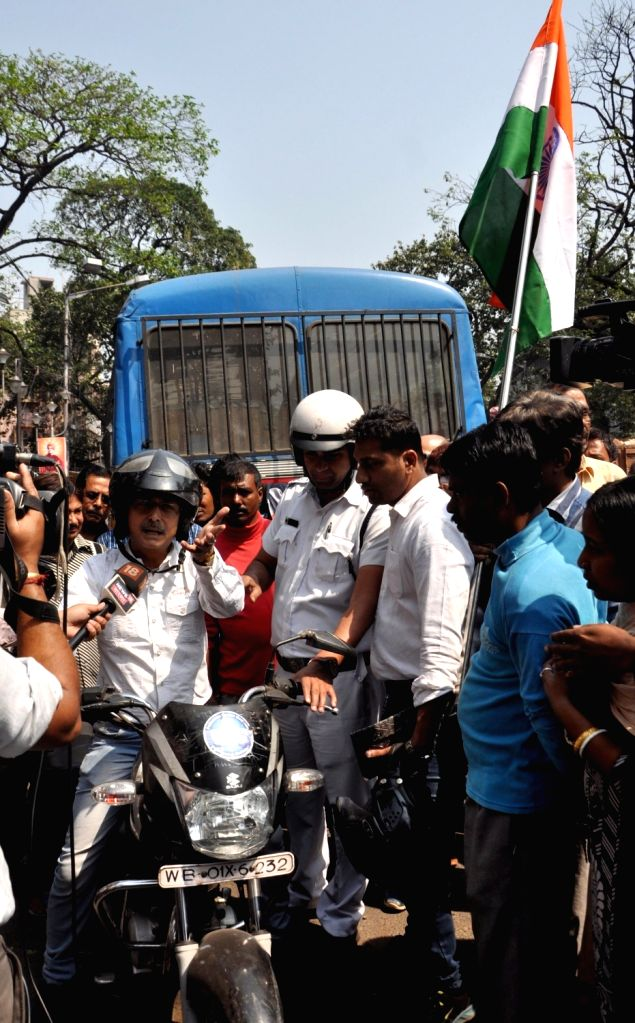 Security personnel detain BJP workers who took out a bike rally ahead of the Lok Sabha polls, in Kolkata, on March 3, 2019.