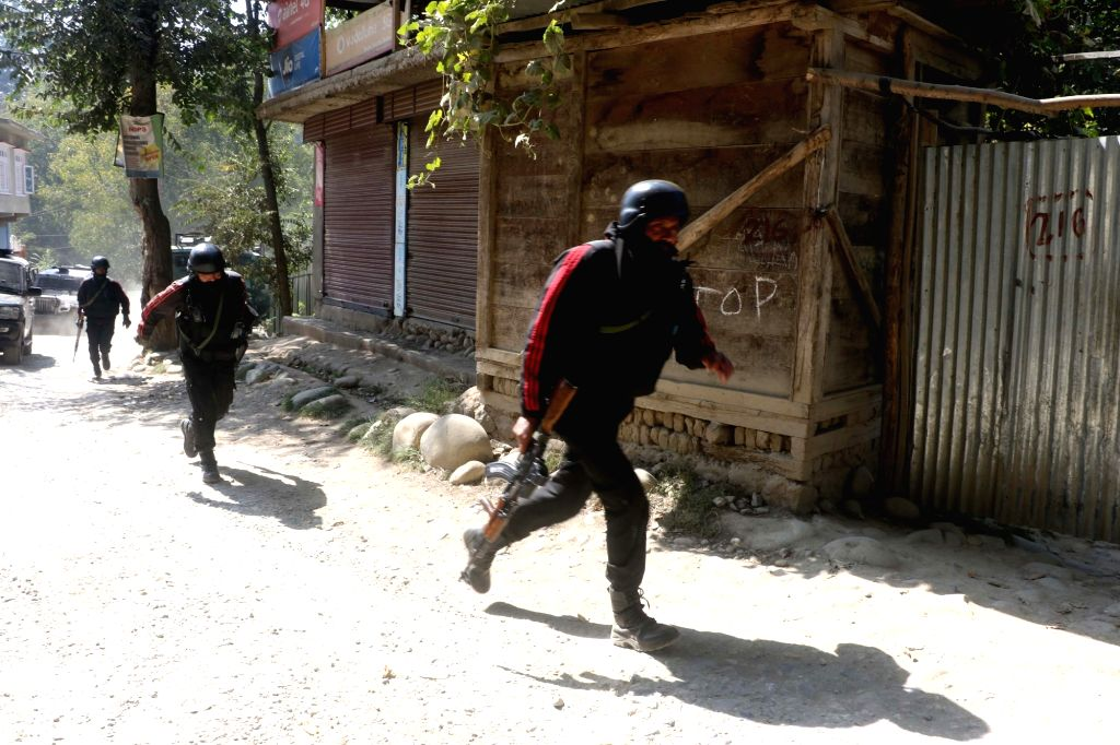 Security personnel during a search operation after three militants were killed in the South Kashmir encounter in Shopian district on Oct 7, 2020.