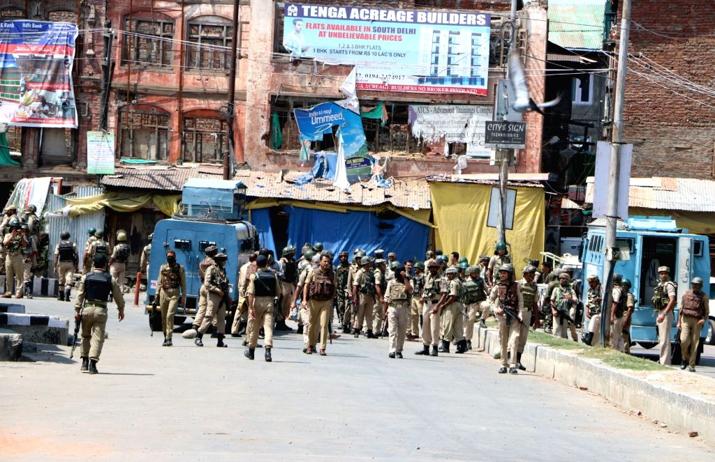 Security personnel during an encounter with militants who attacked security patrol in Srinagar killing a CRPF commandant and injuring nine paramilitary troopers and a local policeman on Aug ...
