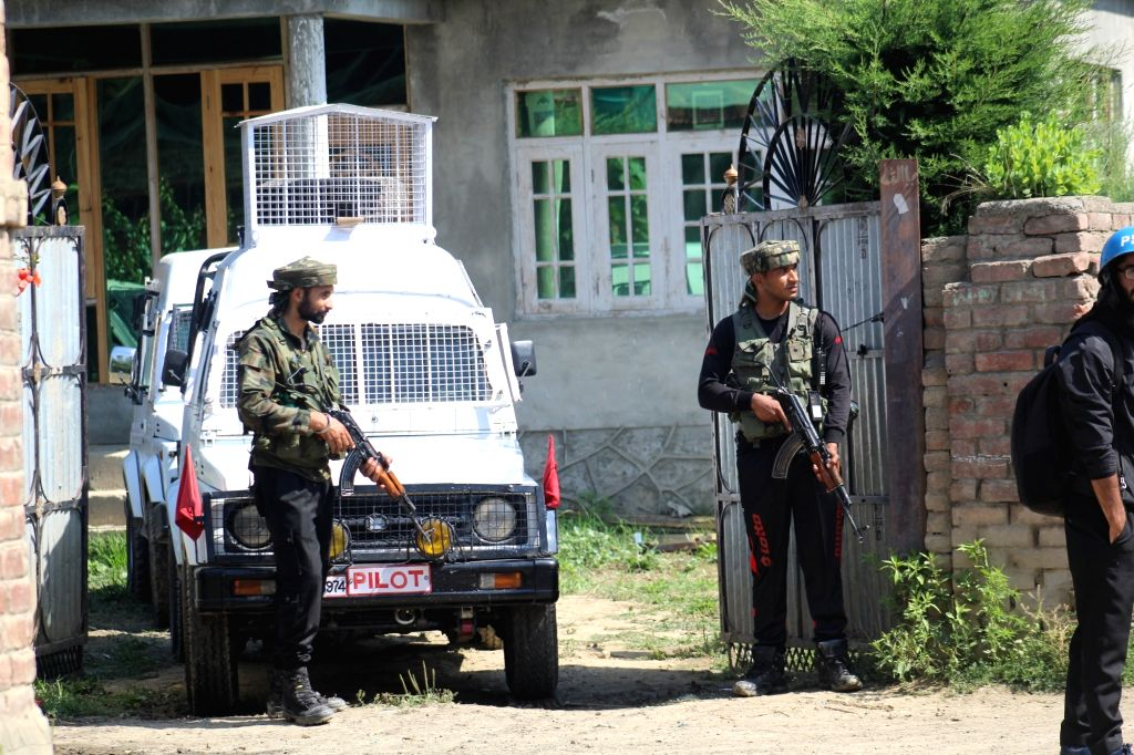 Security personnel during search operations after one militant was killed in a gunfight with the security forces in Jammu and Kashmir's Sopore, on July 17, 2019.