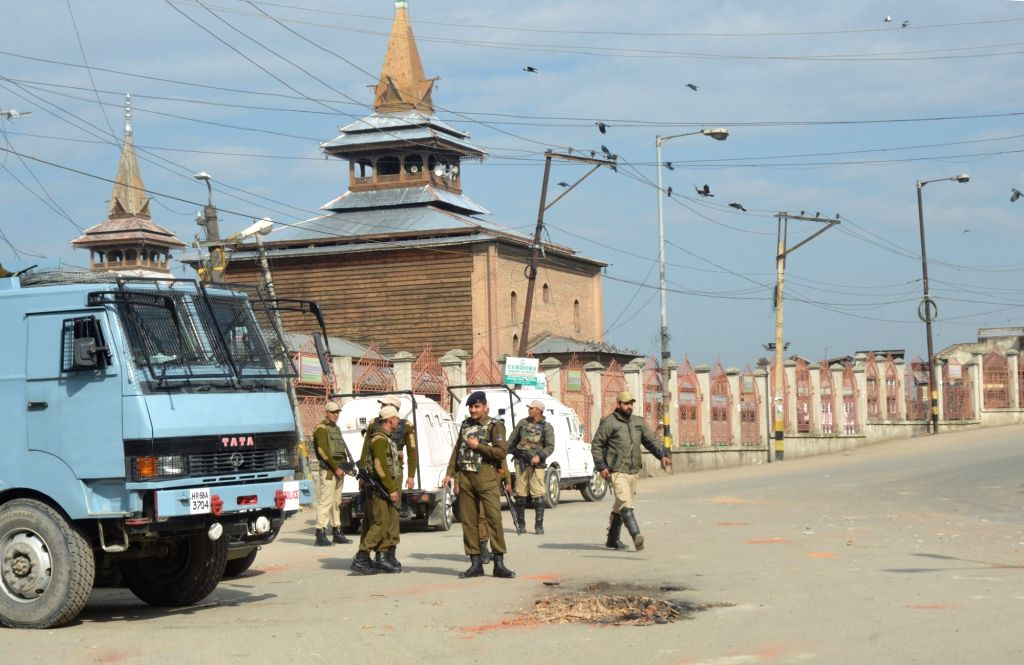 Security personnel enforce curfew imposed by authorities in Srinagar to thwart protests called by the separatists against the killing of four people on April 15, 2016.