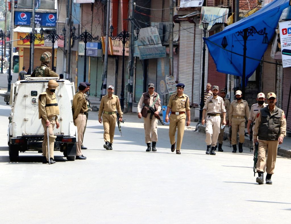 Security personnel enforce curfew imposed by authorities in Srinagar to thwart protests called by the separatists against the killing of four people on April 16, 2016.