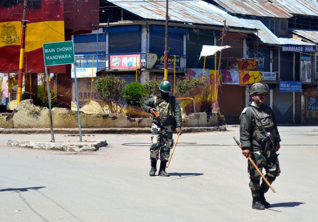 Security personnel enforce curfew in Handwara of Jammu and Kashmir on April 18, 2016.