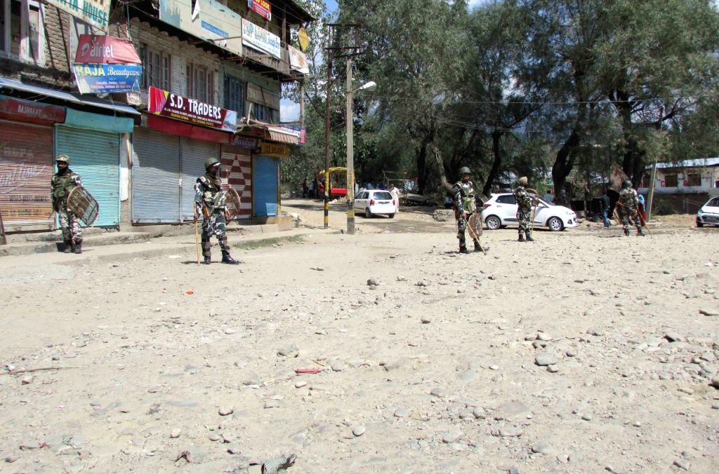 Security personnel enforce curfew in Kupwara of Jammu and Kashmir on April 17, 2016.